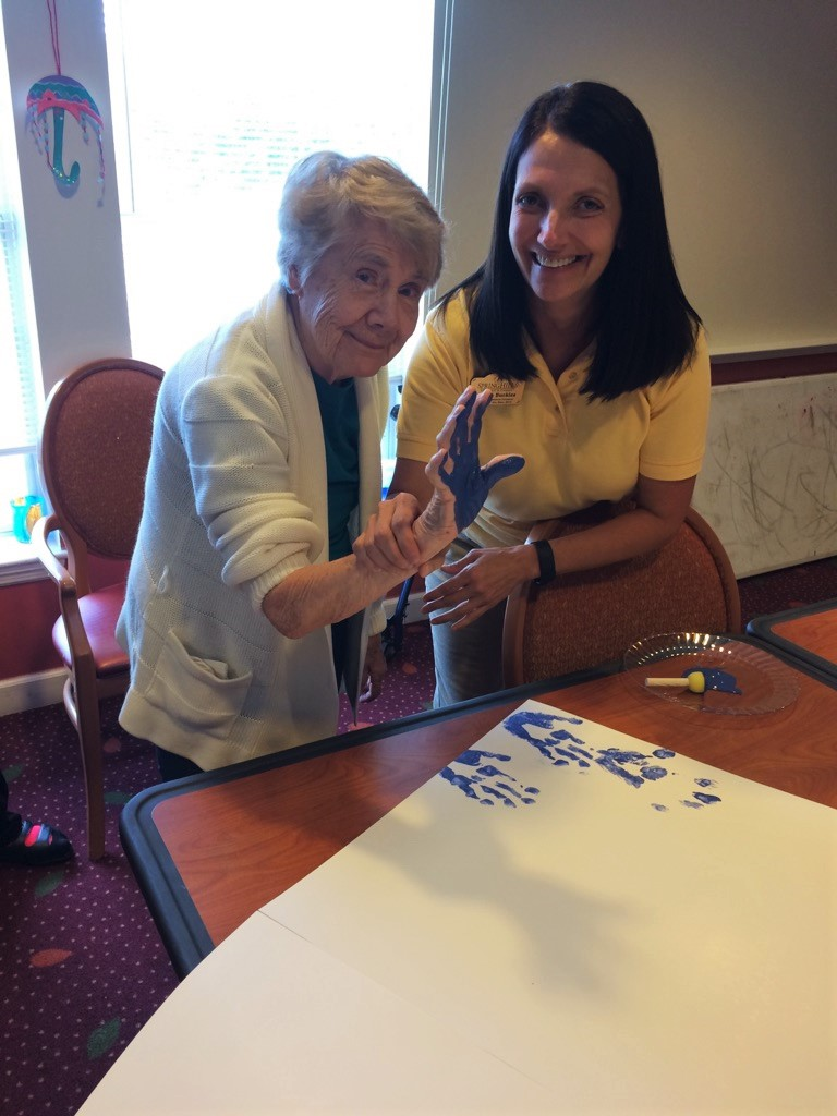 Resident Rita Levreault with Angela Buckles